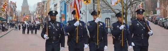 Annapolis Police Department honor guard walking down Main Street for the Martin Luther King Jr. Parade in 2017.