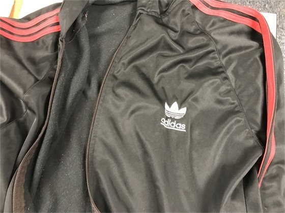 Clothing found with baby - Black Adidas hooded jacket with three red stripes on sleeves