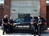 Annapolis Police Department lateral officers with police car.