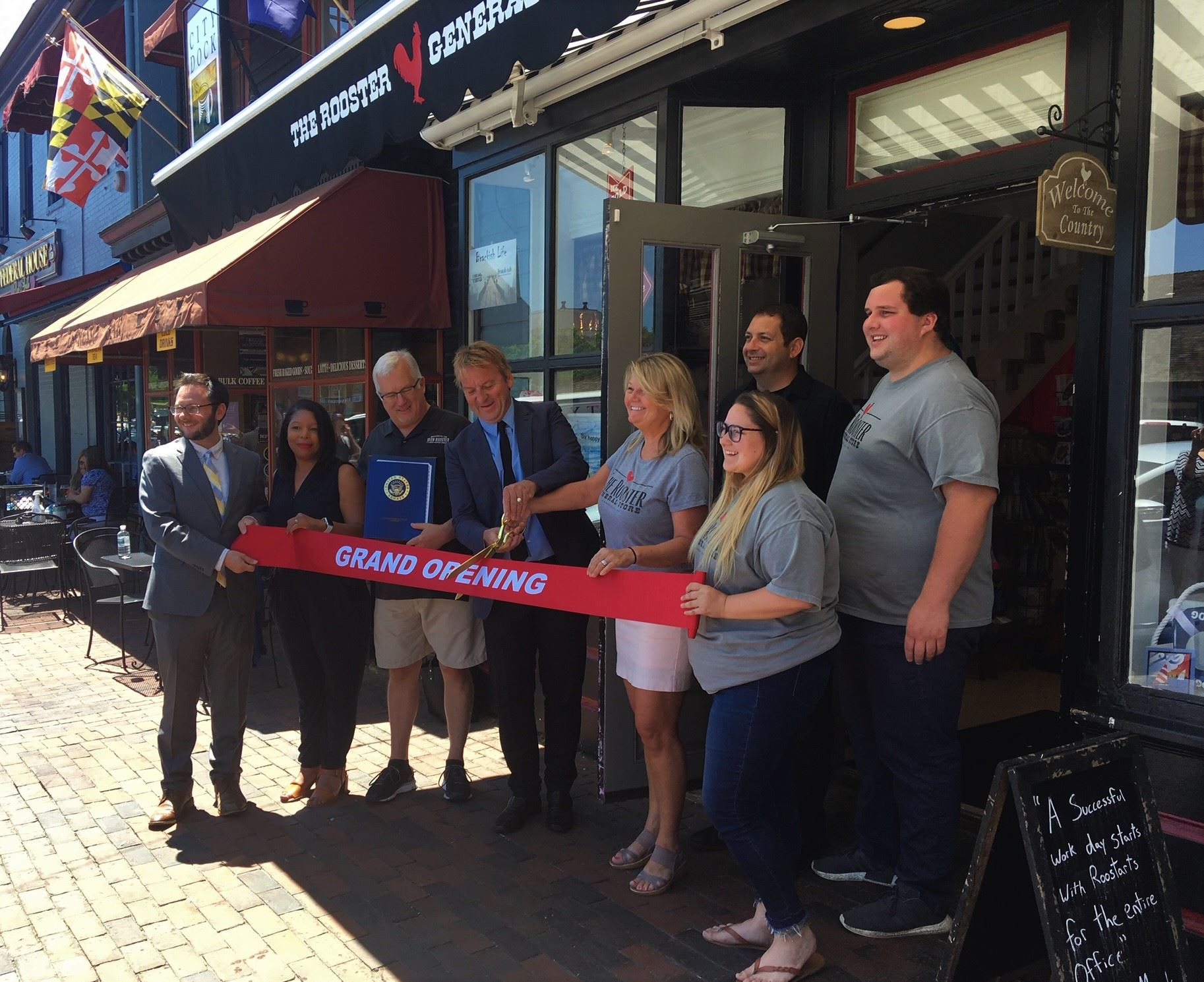 Mayor Buckley cuts the ribbon at Iron Rooster General Store