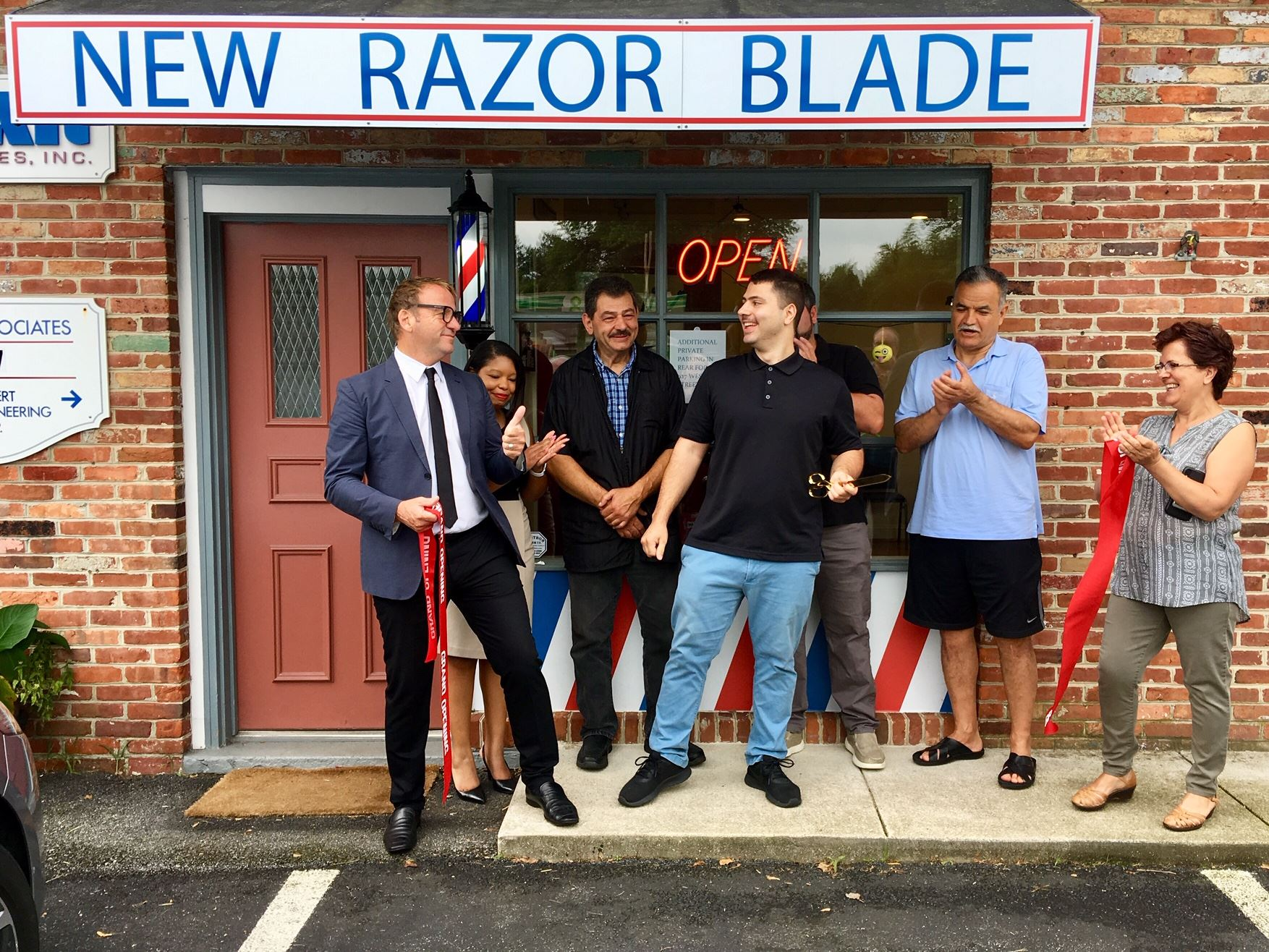 Mayor Buckley cuts the ribbon at New Razor Blade Barber Shop