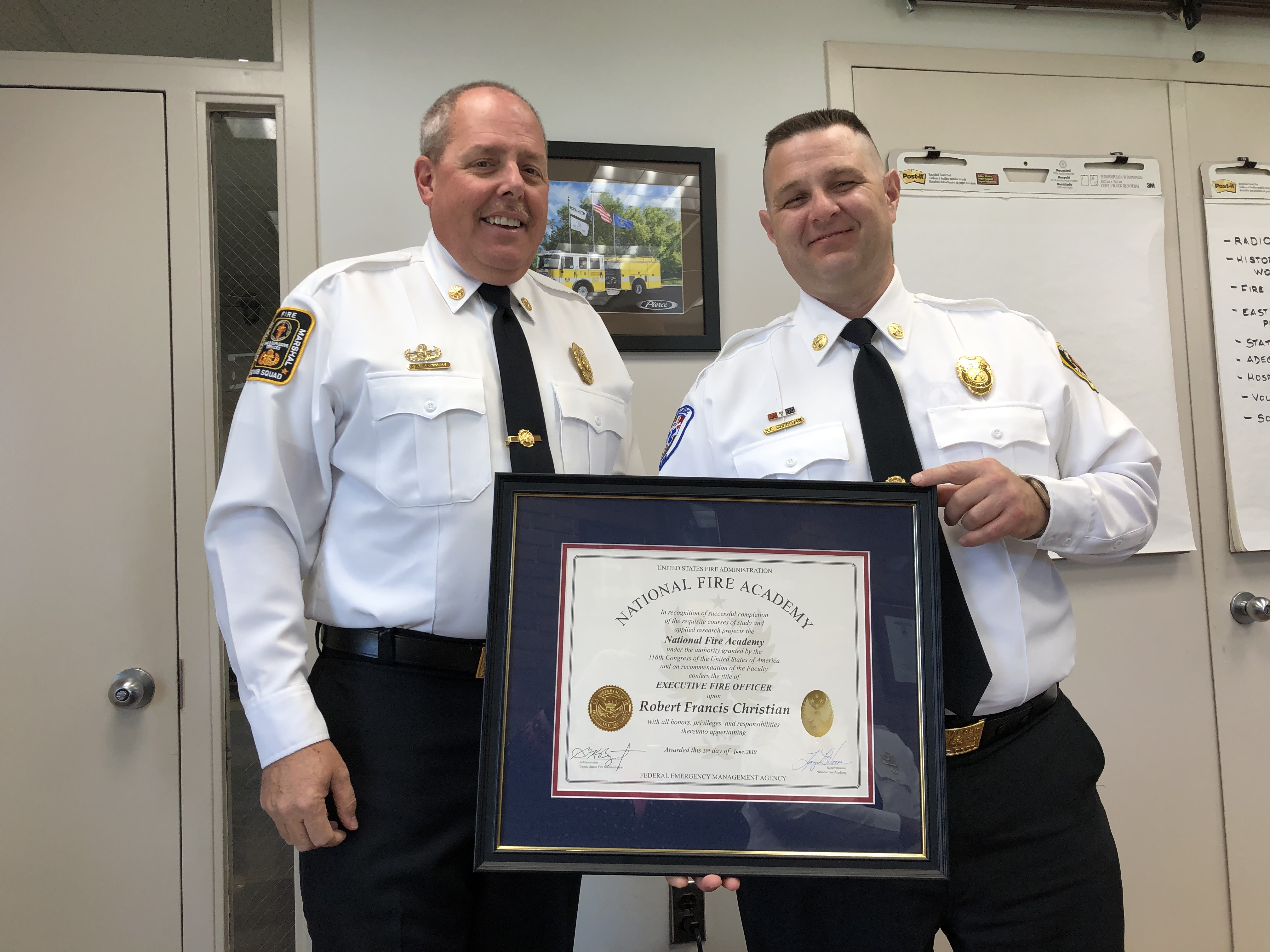 Fire Chief Remaley presented BC Christian with an Executive Fire Officer award