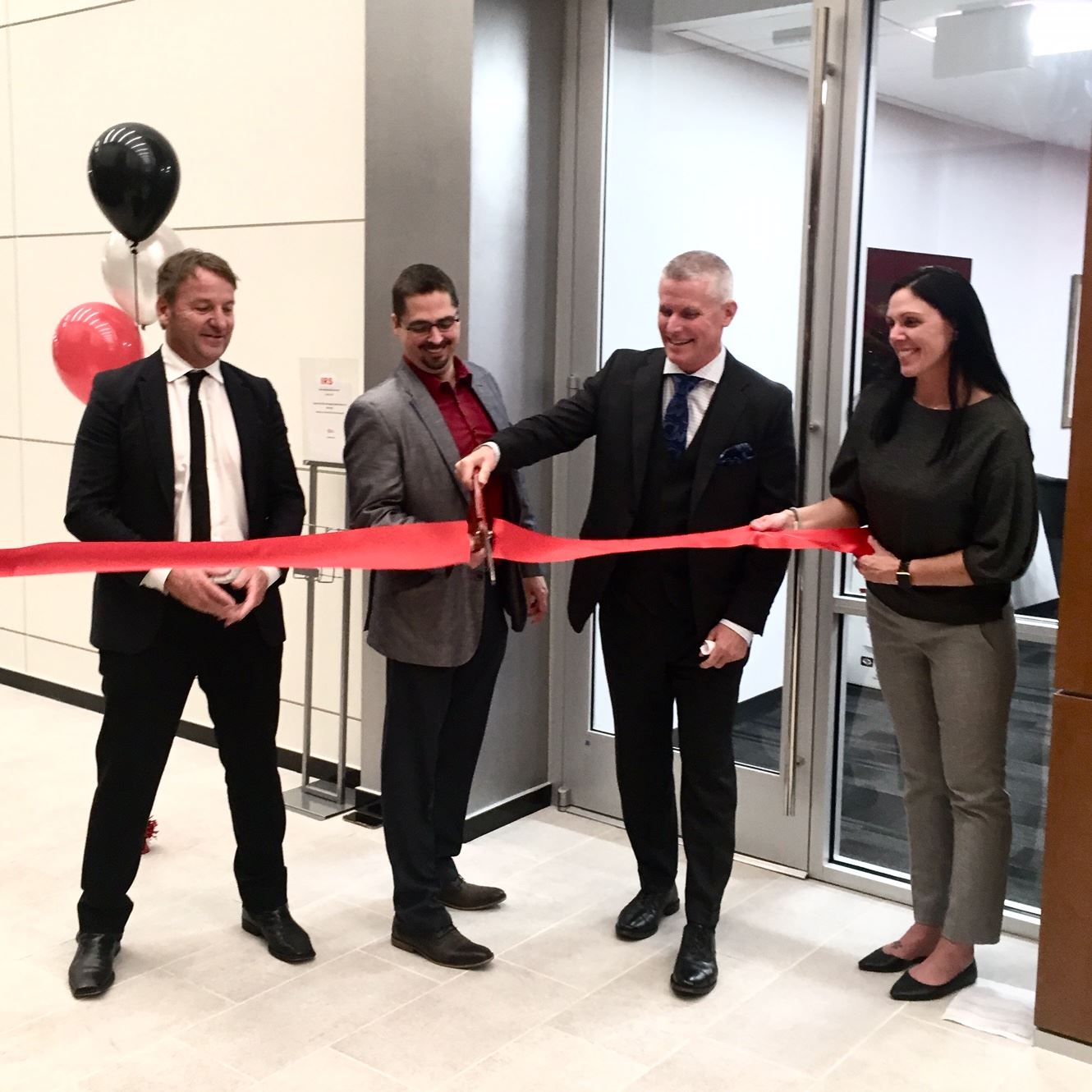 Mayor Buckley cuts the ribbon at RedZone Technologies