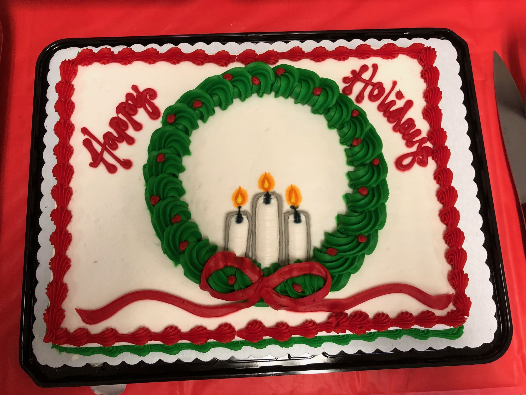 Happy Holidays cake with wreath cancles and ribbon