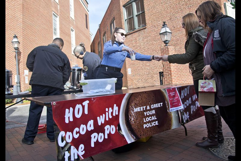 Officer and Cadets serving cocoa.