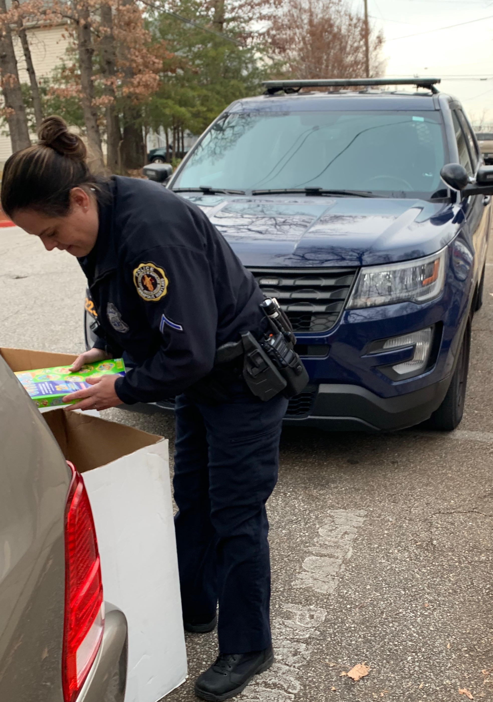 Officer removing toys from a box.