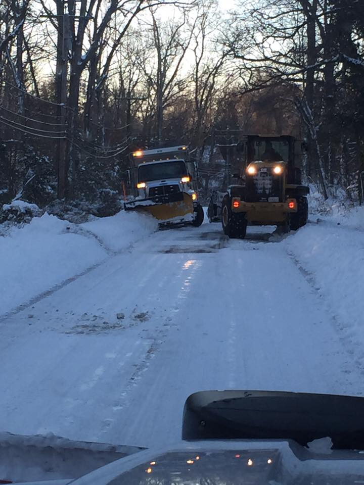 picture of two plow vehicles