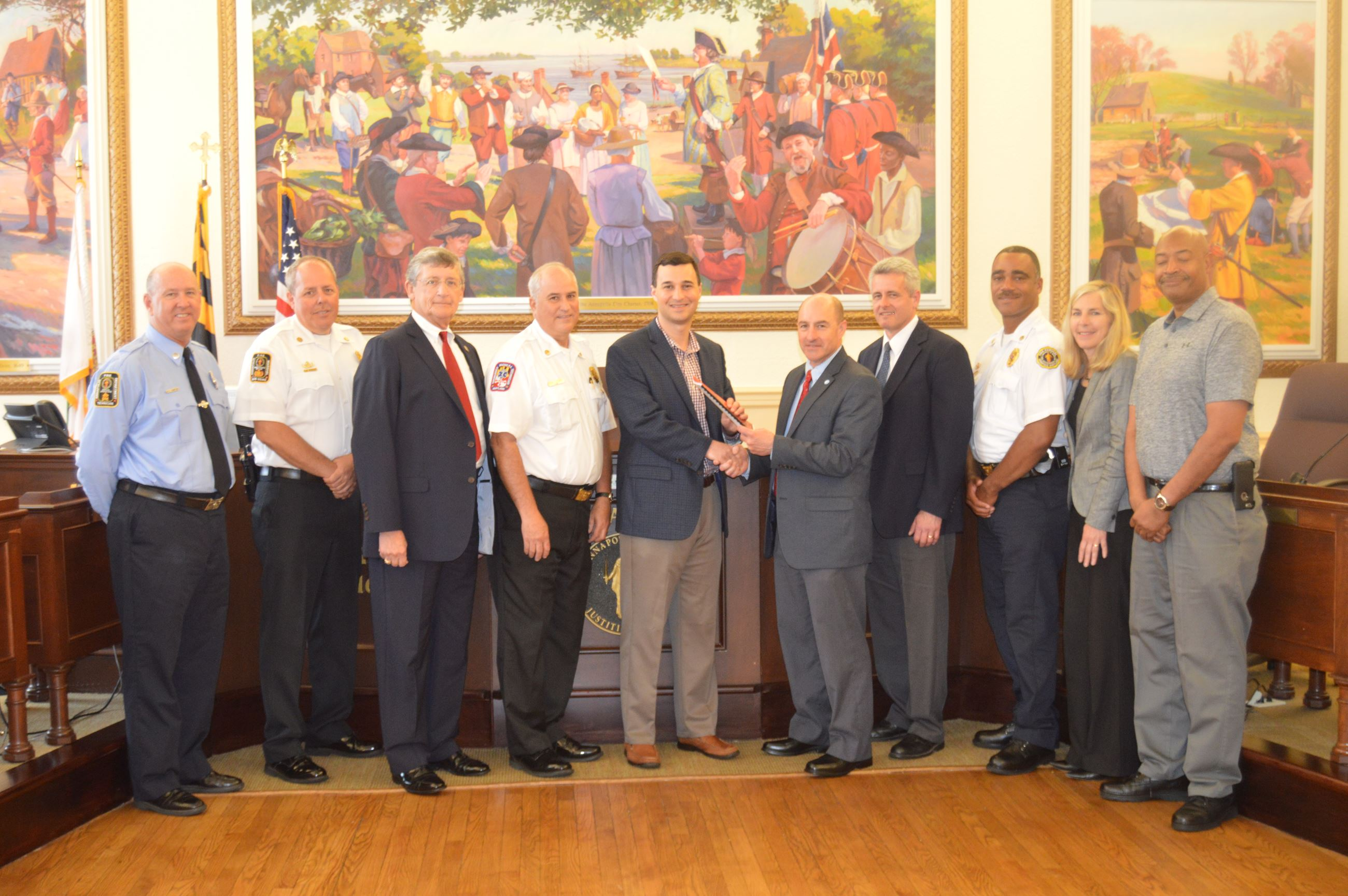 Mayor Pantelides with City Manager, Chief Stokes, representatives from Insurance Service Offices (IS