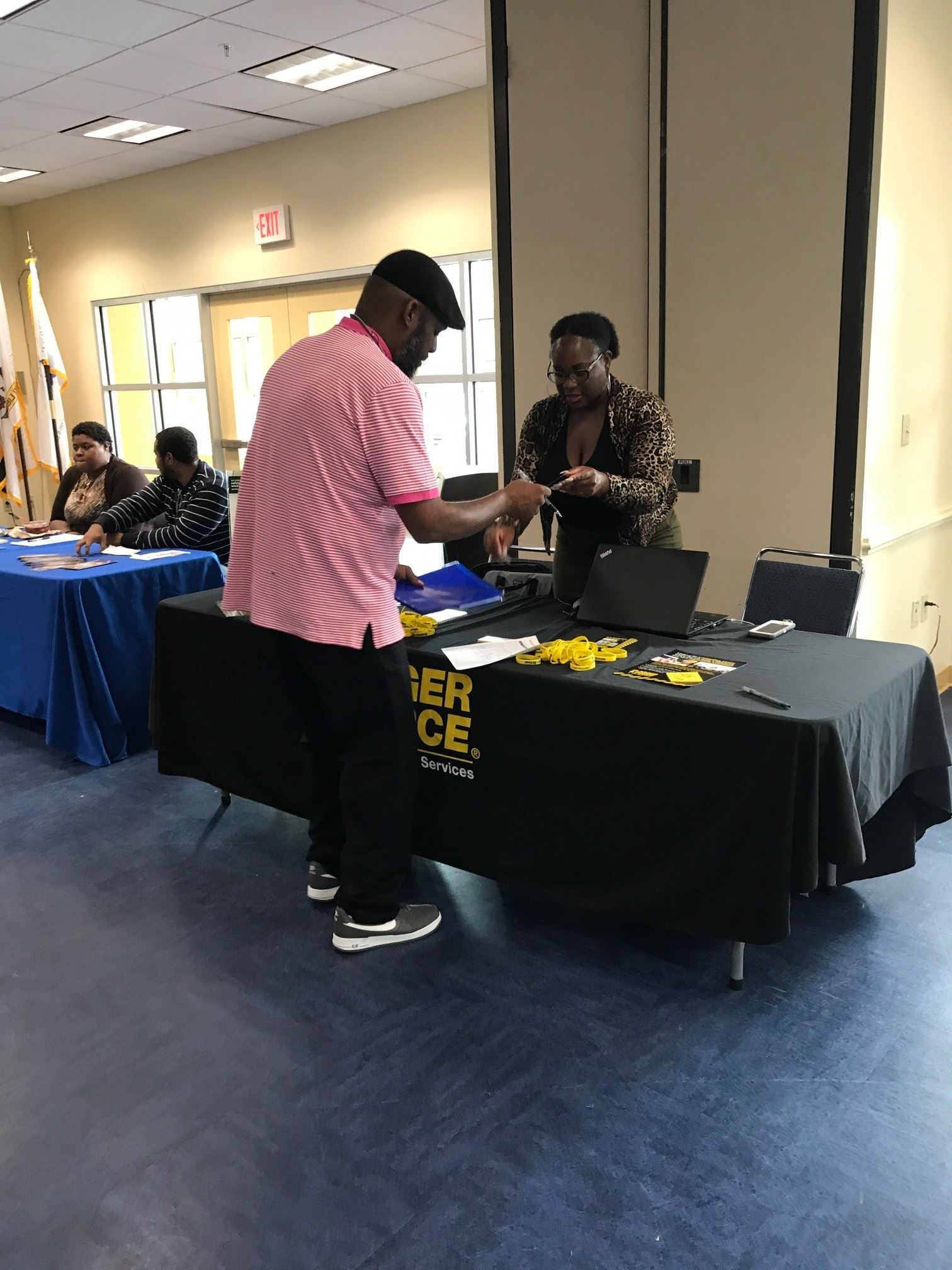 An attendee receives information at the Second Chance Job Fair