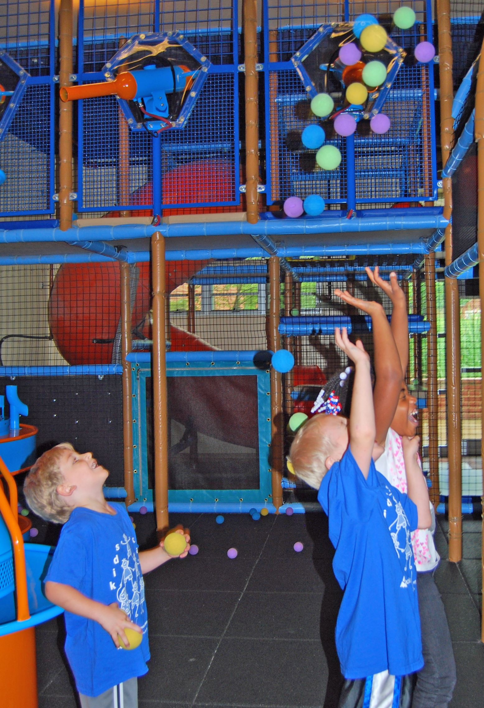 Kids Playing in Indoor Playground with Small Colorful Balls