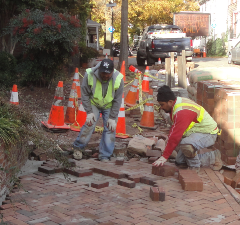 Crew Laying Sidewalk Bricks